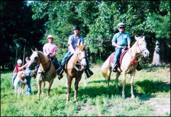 A Family enjoys a trail ride.....Priscilla, Don, Will, & Daisy.